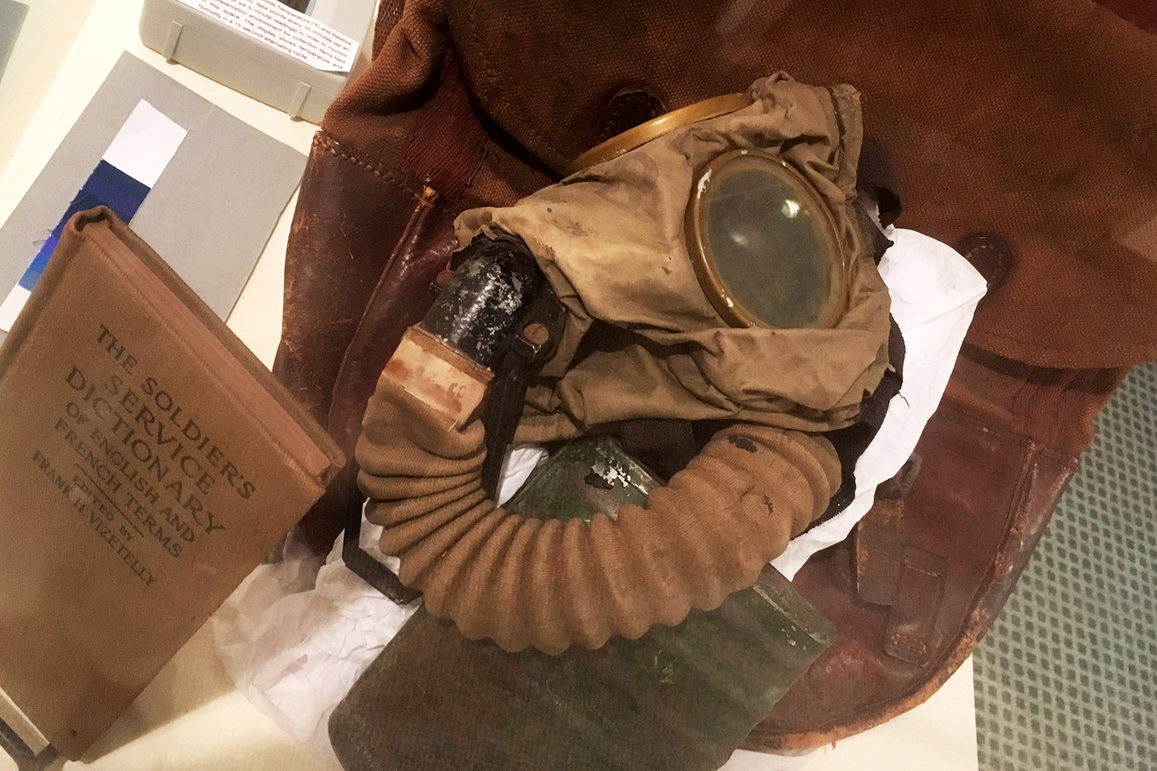 A soldier's gas mask and dictionary of English and French terms